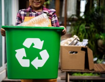 African Descent Kid Holding Recycling Box of Plastic Bottles